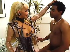 Shemale in latex sucks black cock