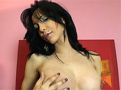 Big tit brunette shemale Karen Zenith strips and jerks off shaved cock